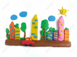 128088970-colorful-plasticine-clay-created-to-be-the-red-car-runs-on-the-city-streets-with-tall-buildings-shad